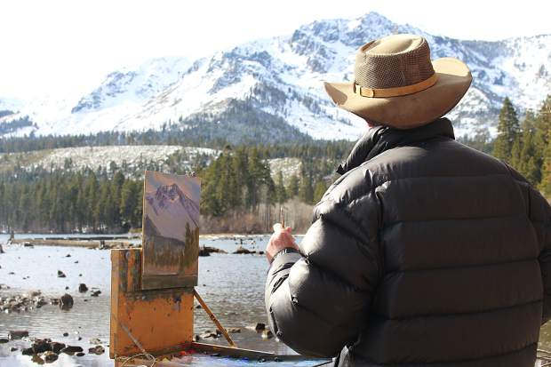 Artist Charles Muench paints Mount Tallac from a beach at Fallen Leaf Lake on Monday, Jan. 22.