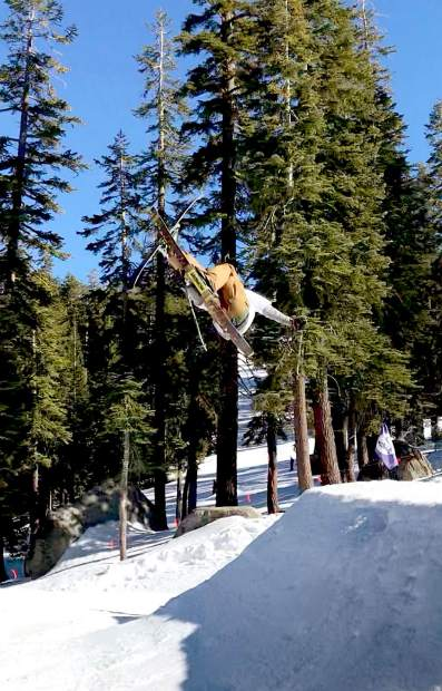 Koa Collin, 15, gets creative on his skis.