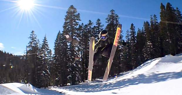 Kai Collin, 15, gets creative on his skis.
