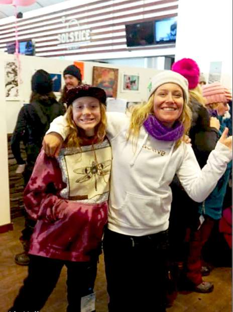 Veda Hallen, 12, poses with South Lake Tahoe two-time gold medalist Jamie Anderson during an event for breast cancer awareness at Sierra-at-Tahoe.