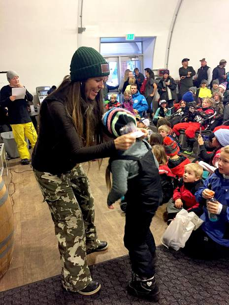 USASA director Bridjet Orr places a medal on an athlete sunday, Jan. 28, at Sierra-at-Tahoe.