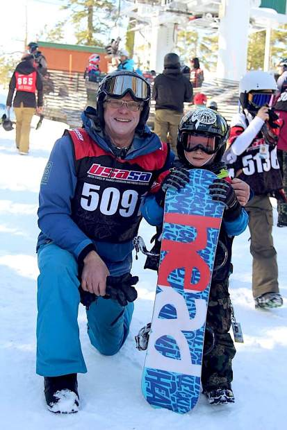 The oldest competitor, Dick Schulze, of Truckee, stands with the youngest competitor Jack Malone, of the South Tahoe Series, Sunday, Jan. 28, at a skier-boardercross event at Sierra-at-Tahoe.