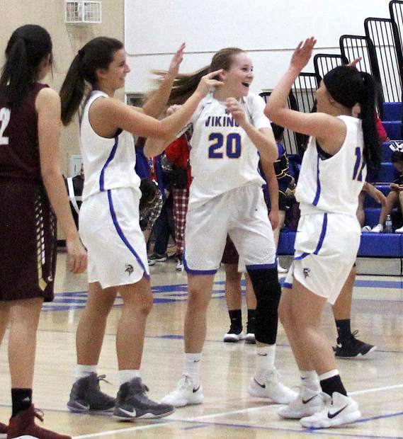 South Tahoe freshmen Eva Perry and Kayleen Conard and Maegan Perez celebrate Perry's putback off an offensive rebound.