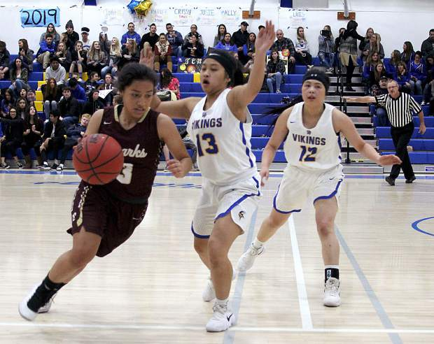 South Tahoe seniors Maegan Perez and Megan Aquino defend a Sparks ballhandler.