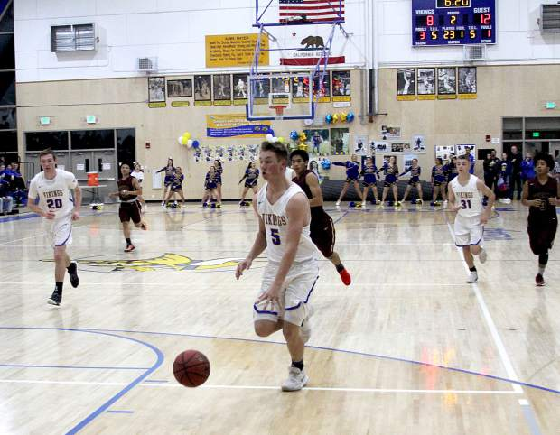 South Tahoe's Kevin Lehmann drives to the basket for a layup.