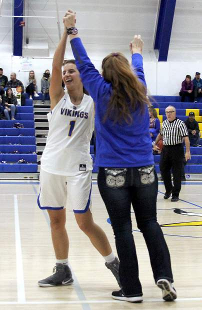 South Tahoe freshman Eva Perry celebrates with Vikings assistant coach Cheryl Vanos Embry.