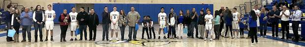 South Tahoe senior basketball players and their families are recognized at halfcourt by fans during senior night against Sparks.