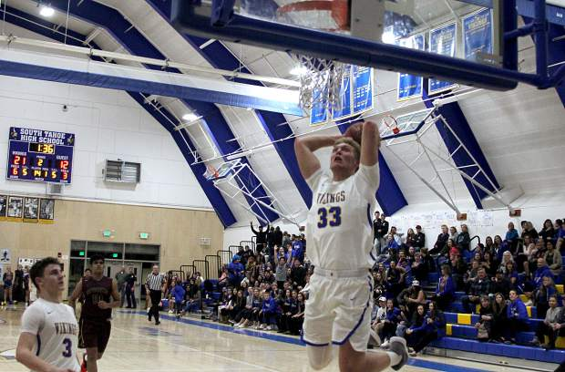 South Tahoe senior McCallan Castles gets ready to bring down the house with a powerful two-handed slam dunk.