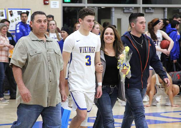 South Tahoe's Matt Cain walls to center court Tuesday, Feb. 7, during senior night.