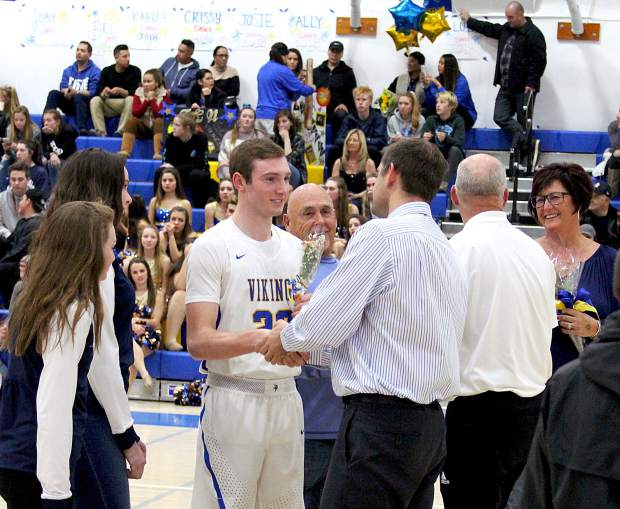South Tahoe's Caleb Moretti shakes hands with Vikings head coach David Finnegan Tuesday, Feb. 7, on senior night.