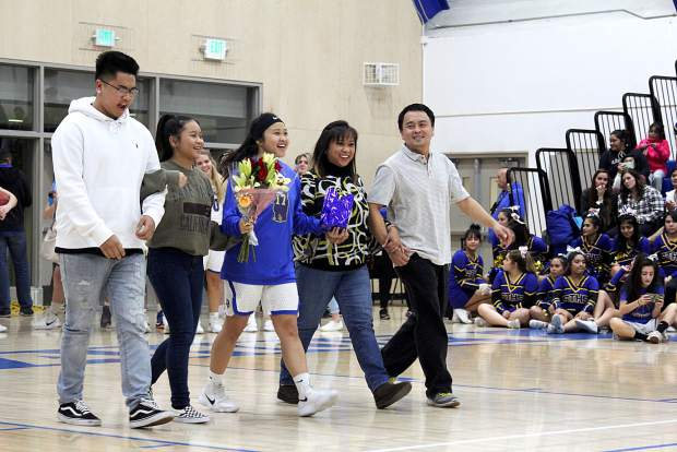 South Tahoe's Maegan Perez smiles big during senior night before the boys' basketball game.