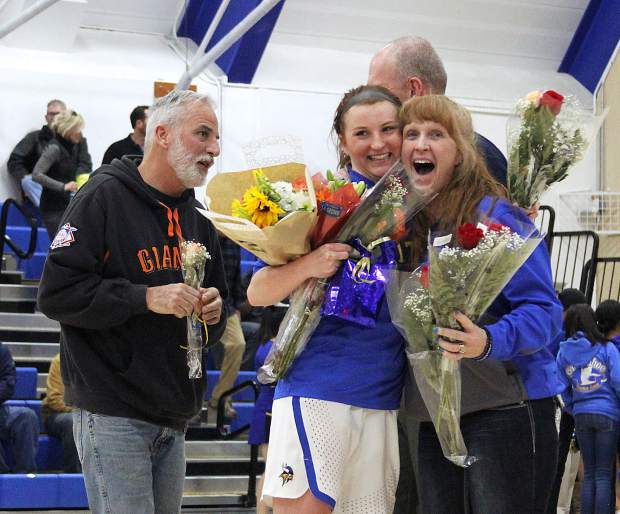 South Tahoe's Bailey Segers gets a big hug from Vikings assistant coach Cheryl Vanos Embry on senior night.