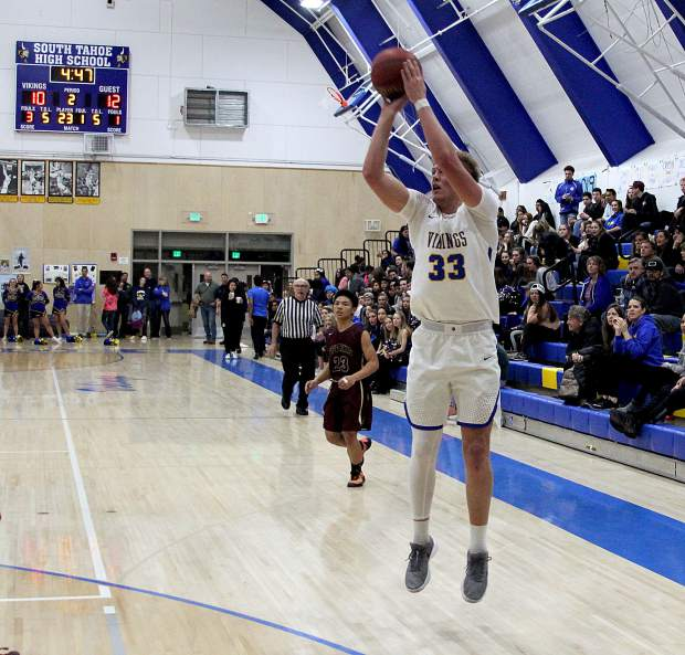 South Tahoe's McCallan Castles drills a 3-pointer to give the Vikings the lead for good over Sparks in the second quarter.