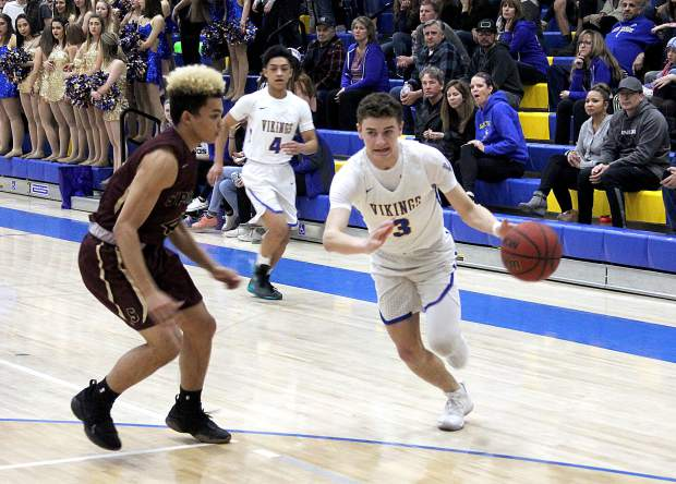 South Tahoe senior Matt Cain drives to the basket for two of his eight points Tuesday, Feb. 7, against Sparks.