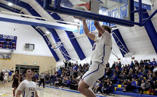 South Tahoe star senior McCallan Castles brings down the house Tuesday night, Feb. 6, with two-handed slam dunk against Sparks.