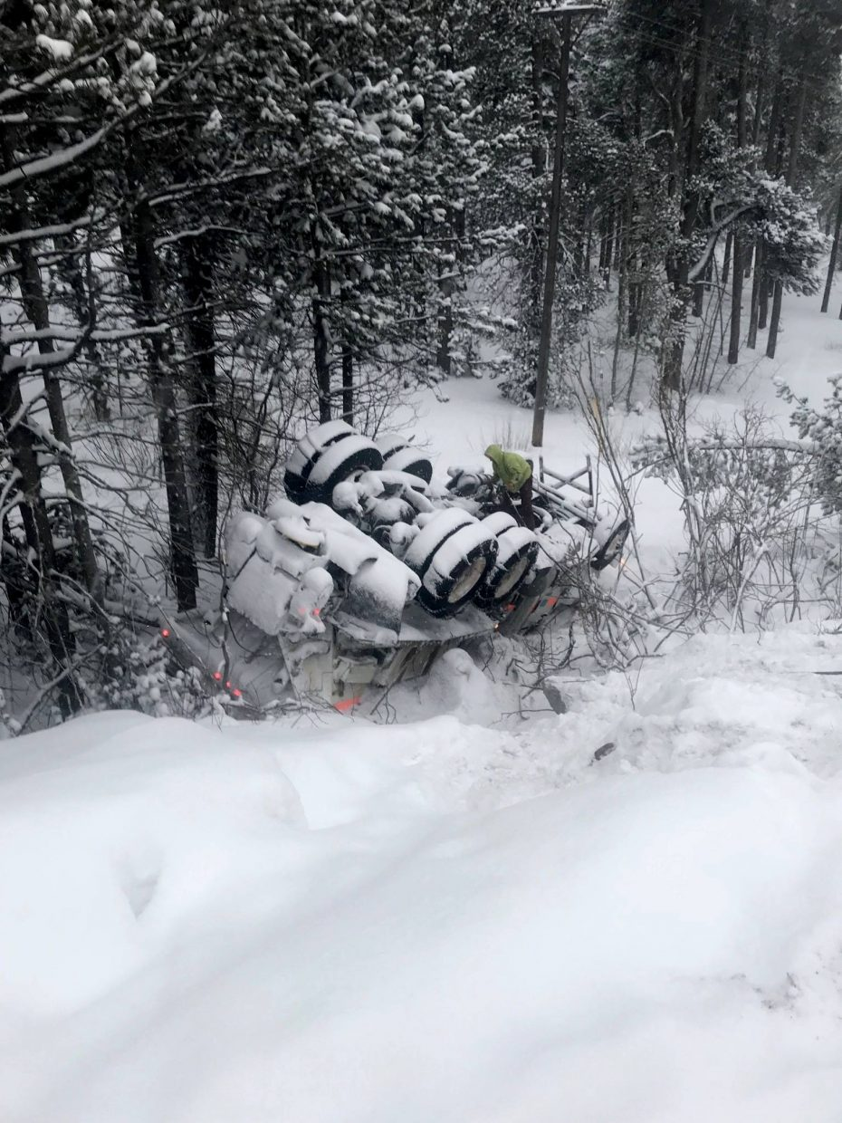UPDATE: Overturned snow plow cleared from Highway 50, chain controls on