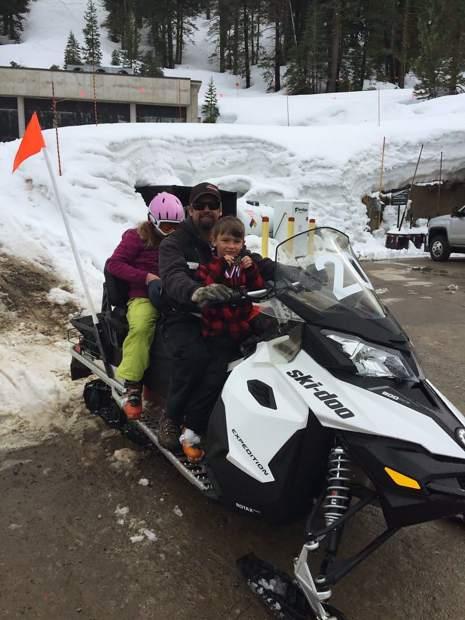 Marty Boline on ski-doo with his son and daughter.