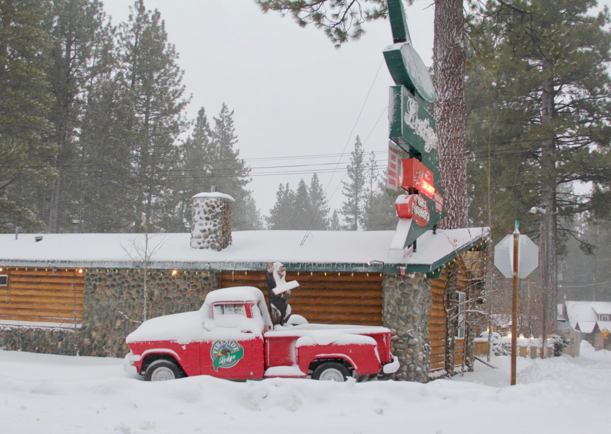 The bright red truck outside Fireside Lodge was a contrast to the snow that topped it.