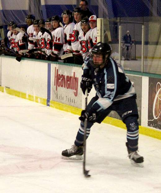 Icemen team captain Phil Heisse looks to make a pass against Bellingham.
