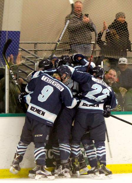 The Lake Tahoe Icemen celebrate a goal by forward Paul Frys on Friday, March 23, against the Bellingham Blazers.