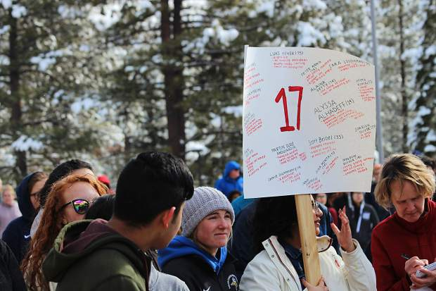South Tahoe High School student Daniella Valdivia held a sign with the names of the 17 Parkland shooting victims.