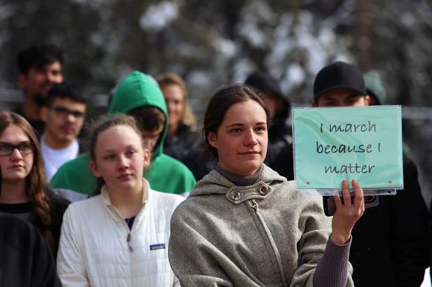 South Tahoe High School student Jessie Brown holds up a sign during the nationwide school walkout on Wednesday.