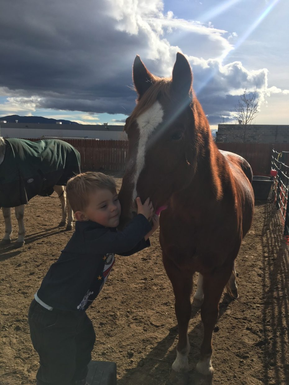 Publisher Rob Galloway's son, Preston, with their horse Casey.