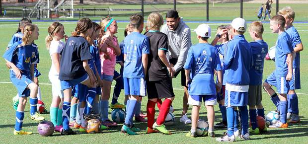A group of campers meet at one of the five stations and get direction from a Reno 1868 player.