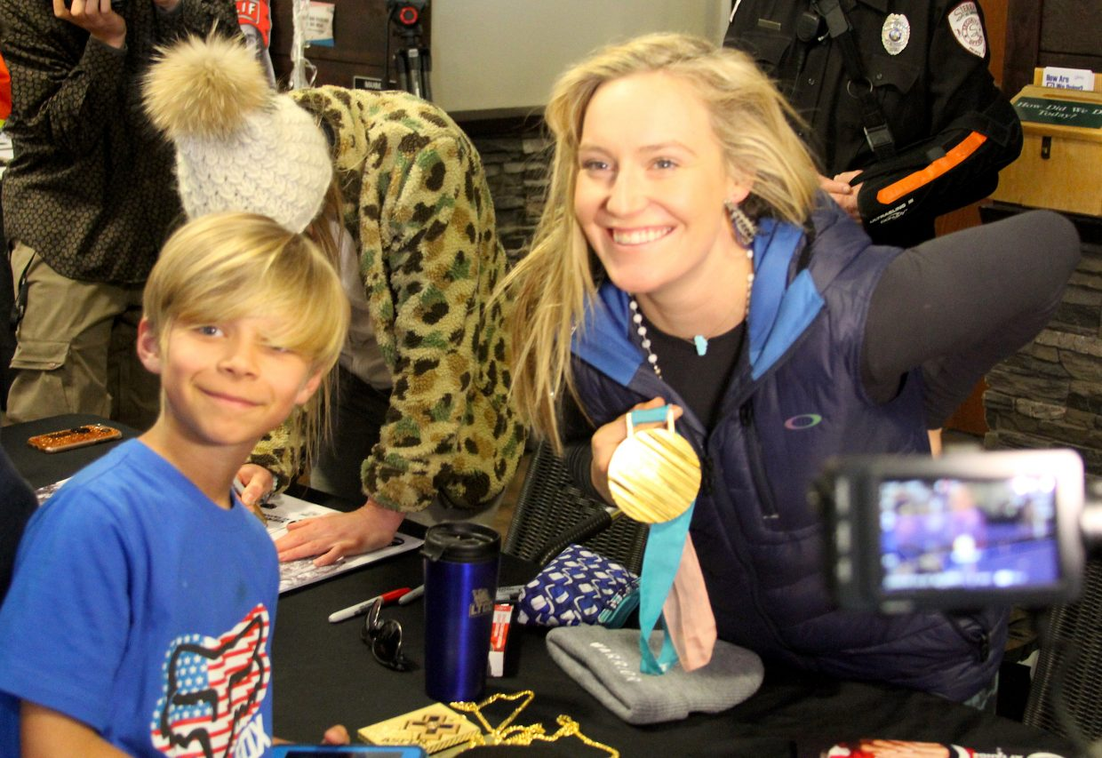 Jamie Anderson signed an autograph and then posed for a photo.