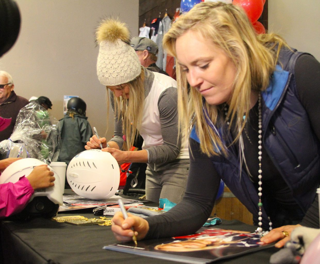 Hannah Teter (left) and Jamie Anderson signed autographs for about an hour Saturday, April 7, at Sierra-at-Tahoe.
