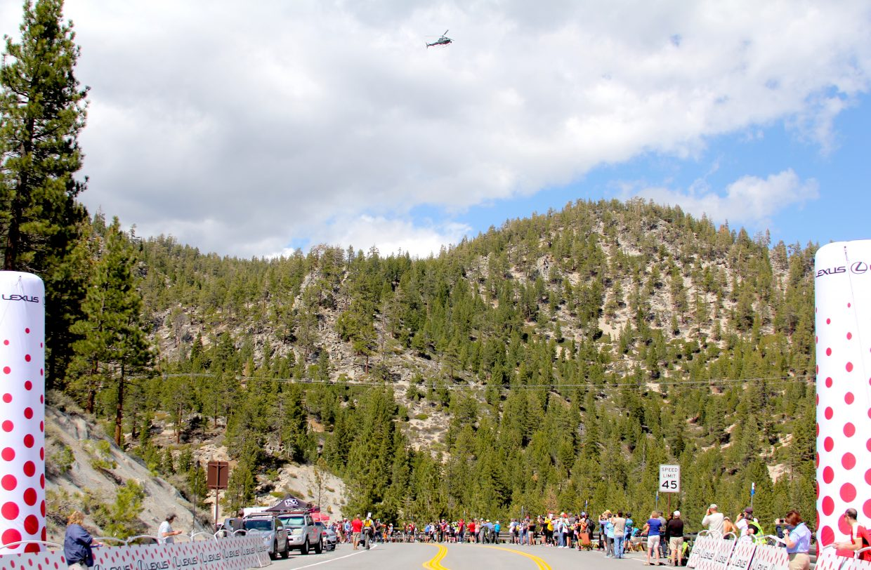 The helicopter provides a live television feed as the Tour of California riders almost reach Daggett Summit.