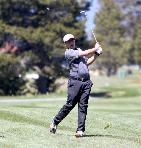 Incline sophomore Satchel Hirsch plays an approach shot on the second hole.
