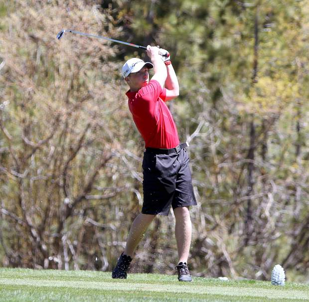 Whittell senior Conner Huber tees off on hole No. 18.