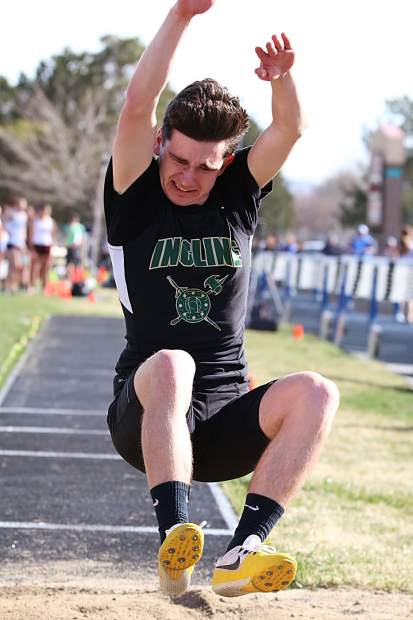 Incline's DJ Littleton competes in the long jump earlier this season.