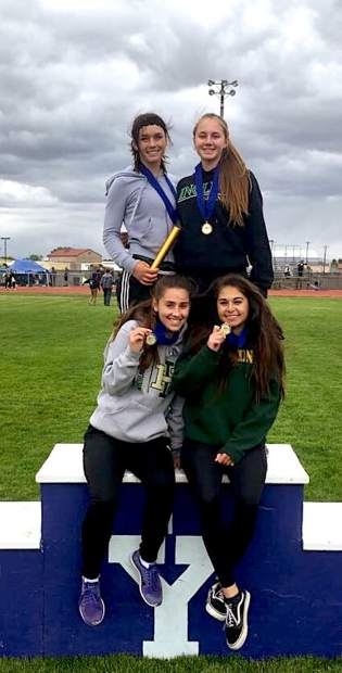 The winning Incline 4x200 relay team consists of Belle Johnson, Emma Perrell, Millie Jenkins and Sami Giangreco.