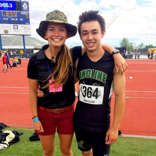 Incline senior Noah Cleary stands with pole vault coach Sarah Hockensmith after he recorded a season's best height of 10 feet, 6 inches to finish in fourth place at the state championships.