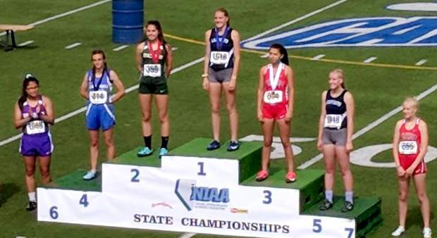 Incline freshman Millie Jenkins stands in the second position where she received a medal in the 100-meter hurdles.