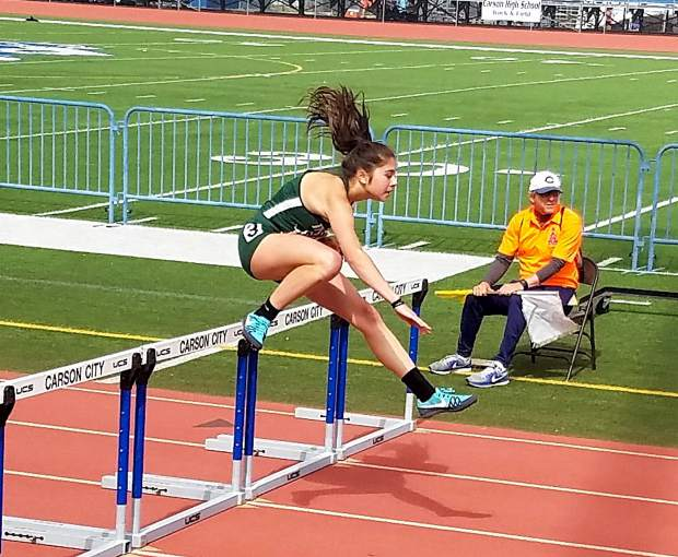 Incline freshman Millie Jenkins runs the 100-meter hurdles at the state championship track and field meet in Carson City, Nevada.