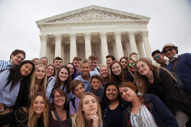 "The ""We the People"" team poses for a photo outside the United States Supreme Court."