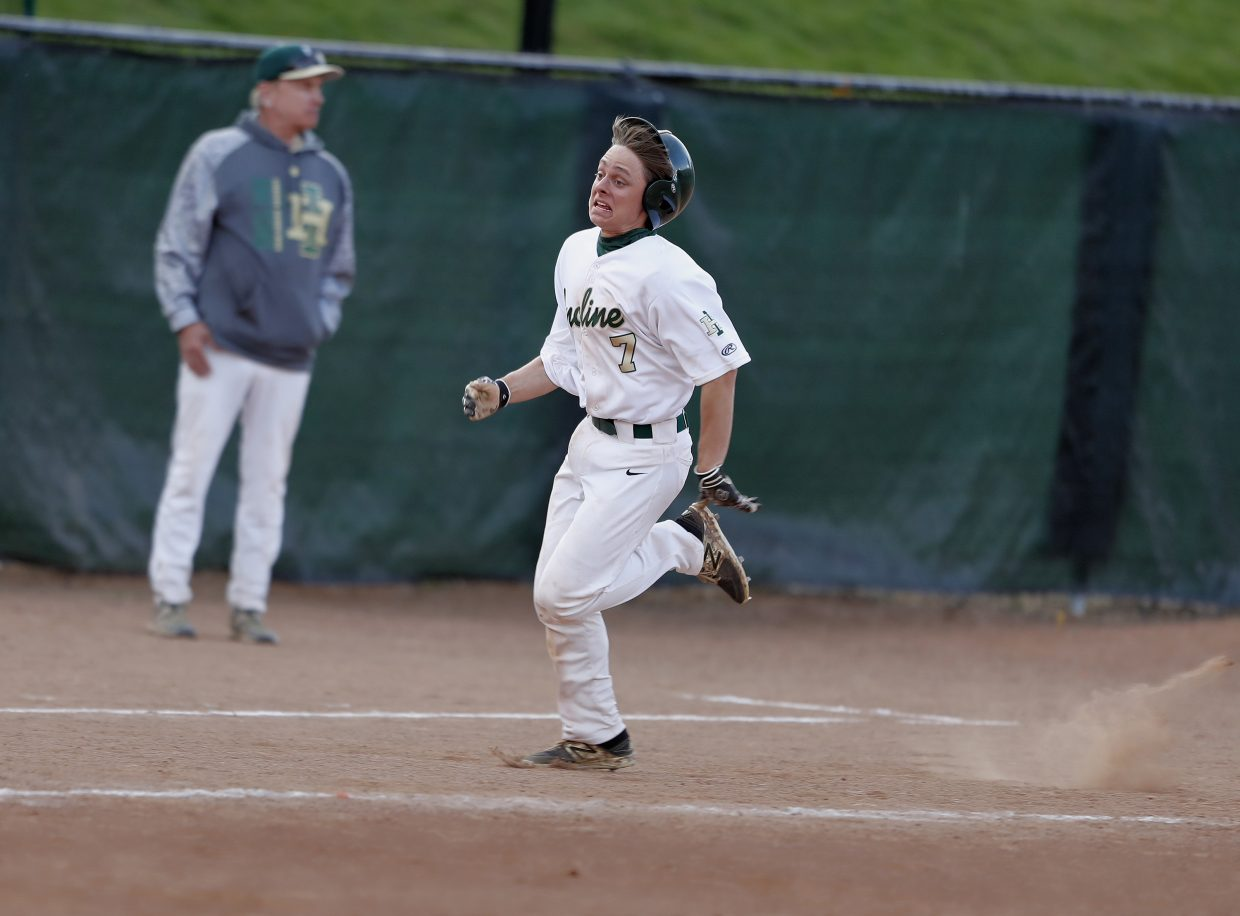 Incline's Zach Paolilo sprints to home plate Friday in the seventh inning.