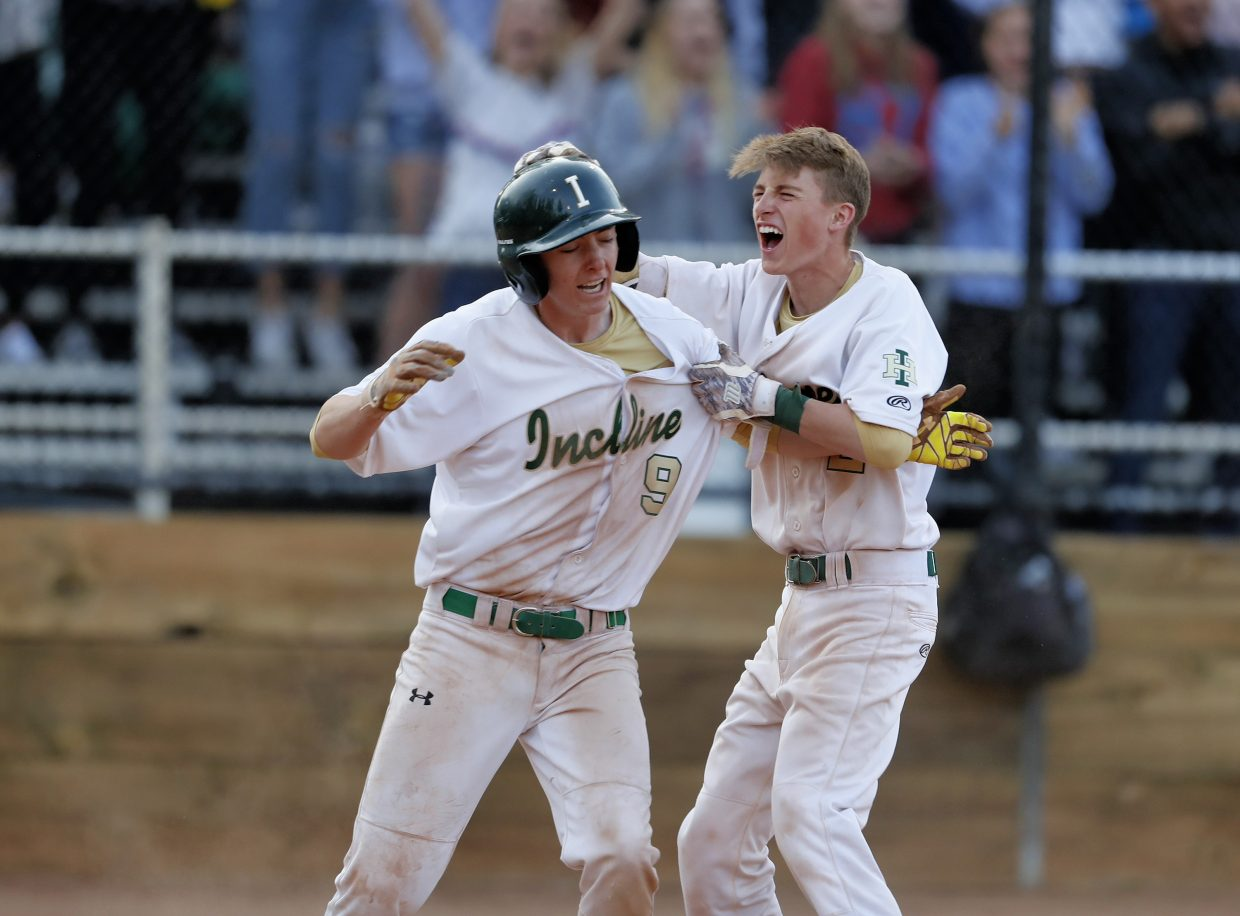Incline's Brayden Snearly (9) and Brayden Hock celebrate the Highlanders victory against Battle Mountain.