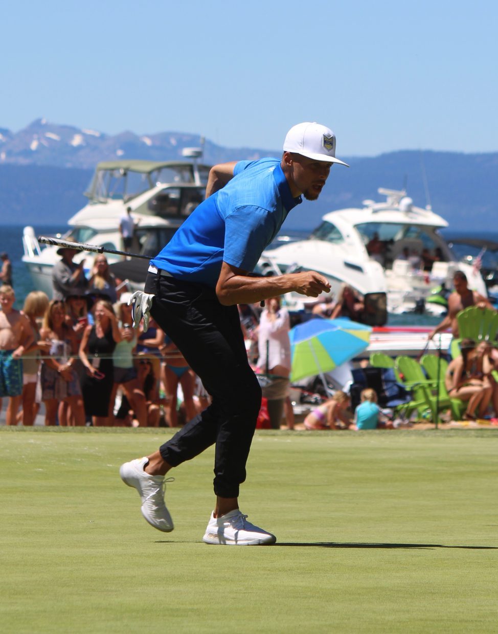 Steph Curry sinks a putt on hole 17 on Sunday during the 2017 celebrity golf tournament.