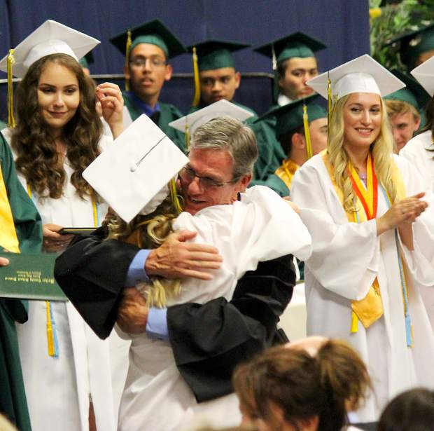 Incline principal Dr. Andrew Yoxsimer hugs a student during the diploma ceremony.