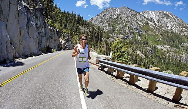 A competitor last year runs a leg of the DeCelle Memorial Lake Tahoe Relay.