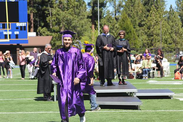 A student smiles after receiving his diploma on Friday.