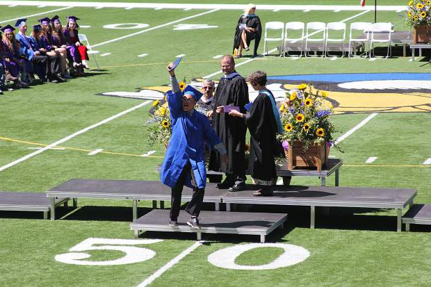 A student cheers upon receiving his diploma on Friday.