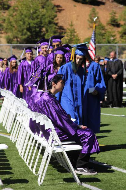 Students arrive and take their places at Friday's graduation.