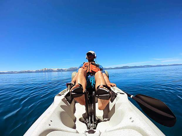 Nice calm day on Lake Tahoe. Why paddle when you can pedal...
