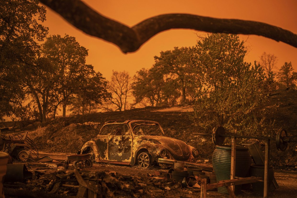 A Volkswagen Beetle scorched by a wildfire called the Carr Fire rests at a residence in Redding, Calif., Friday, July 27, 2018. The wildfire roared with little warning into the Northern California city as thousands of people scrambled to escape before the walls of flames descended from forested hills onto their neighborhoods, officials said Friday.