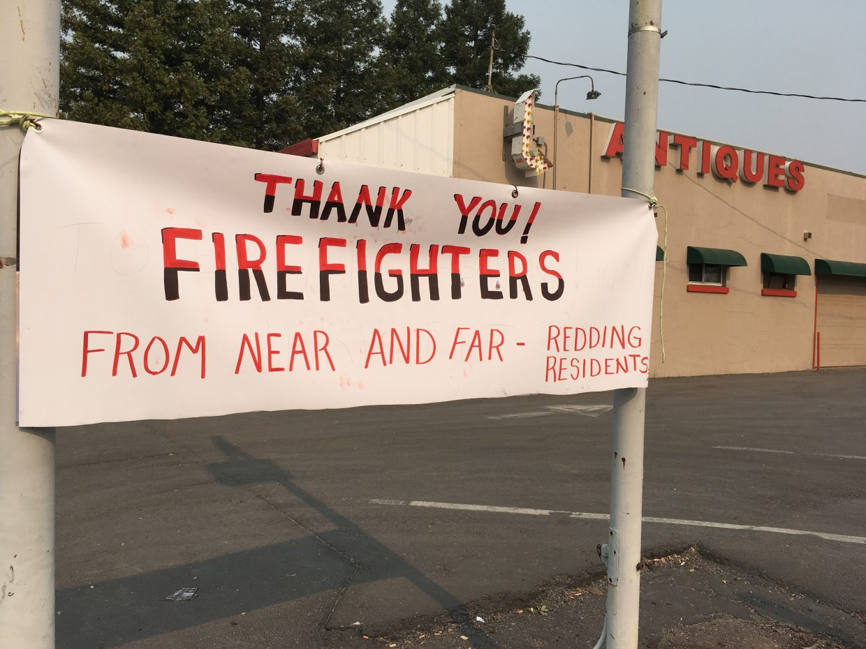 A sign thanking firefighters is see in Redding, Calif., Sunday, July 29, 2018. Fire crews faced many uncertainties Sunday as they struggled to corral a deadly blaze in Northern California that left thousands of dazed evacuees reeling as they tried to take care of themselves and their pets. Crews endured hot temperatures and remained wary of the possibility of gusty winds, said Anthony Romero, a spokesman for the California Department of Forestry and Fire Protection.